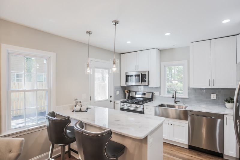 Real Estate Photography, white washed kitchen with two seats
