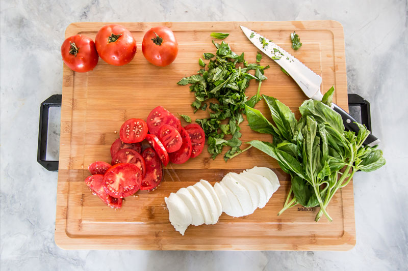 Commercial Photography & Videography, branding shot of cutting board and chopped vegetables